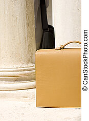 Leather bag next to the columns