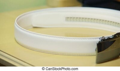 Leather Belt - Man putting on his leather belt