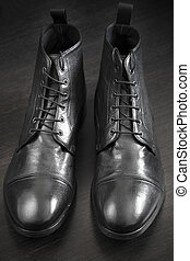 Leather Boots - premium leather shoes, selective focus on...