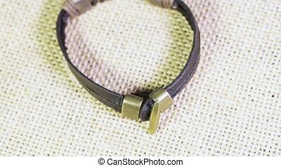 Leather bracelet on burlap