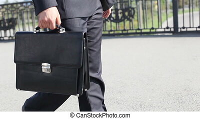 Leather briefcase - Close-up of a business guy carrying a...