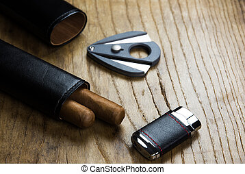 Leather case with cigars, lighter and cigar cutter