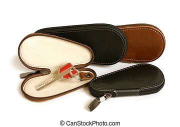 Leather cases for keys on a white background