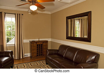 An old fashioned, masculine den with leather furniture