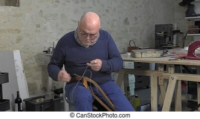 leather goods master craftsman - Traditional sewing leather...