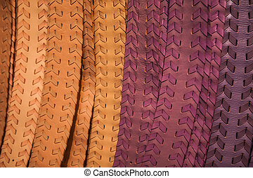 Leather handmade colorful belts on market