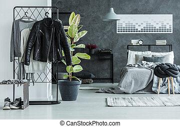 Leather jacket in teenager's bedroom