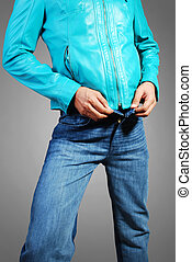 Beautiful leather jacket and jeans wearing a model isolated on a gray background.