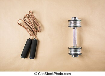 Leather jumping rope and a dumbbell