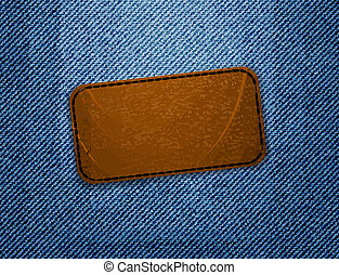 Leather label on jeans background.