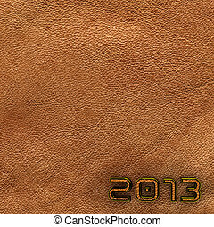 Leather new year 2013 background. Brown.