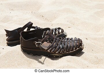 Leather Sandals on Sand - Leather sandals on the beach sand ...
