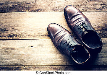 Leather shoes on the wooden floor.