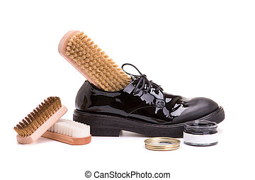 Leather shoes with a set for shoe service on a white background.