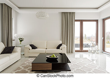 Leather sofa and wooden table - Photo of luxurious leather...