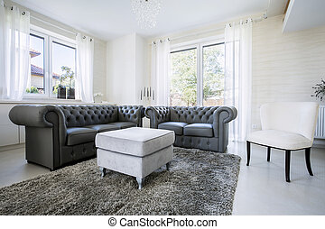 Leather sofa in bright living room - Black leather sofa in ...