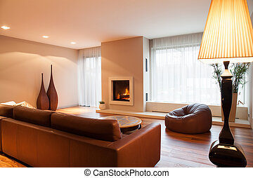 Leather sofa in drawing room - Brown leather sofa in luxury ...
