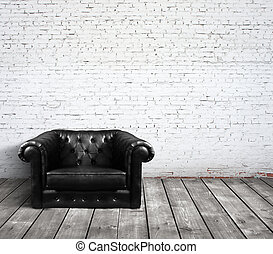 leather sofa in brick room