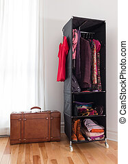 Leather suitcase and mobile wardrobe with clothing