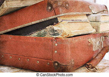 suitcase filled with old books