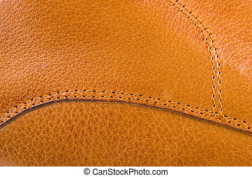 leather texture - tan leather material jointed by thread...