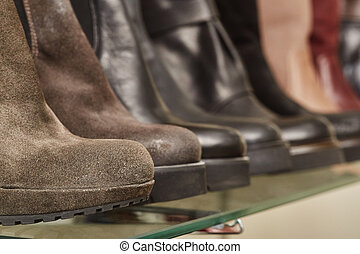 Leather women's boots on the shelves in the store