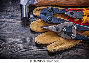 Leather working gloves pliers steel cutter tin snips claw hammer.