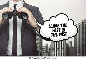 Leave the past in the past text on speech bubble with businessman holding binoculars