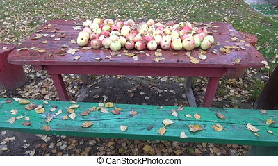 Leaves and apples on table