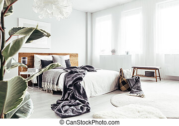 Leaves in bright bedroom