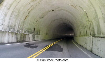 Leaving a Tunnel - A car quickly enters, drives through, and...