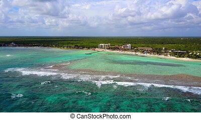 Leaving island beach resort - Panning away beach resort over...