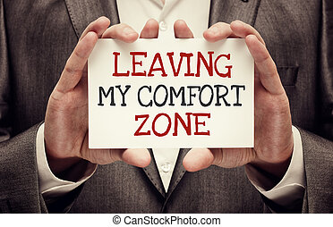 Leaving My Comfort Zone. Businessman holding a card with...