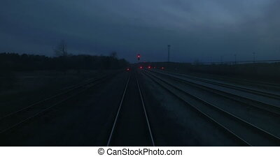 Leaving railway at night - View to railroad tracks from last...