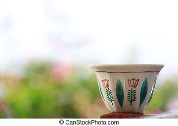 Lebanese Coffee Cup on Floral Background
