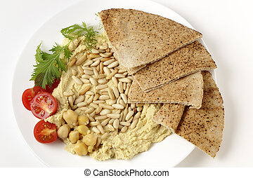 Lebanese hummus and pine nuts from above - Lebanese hummus...