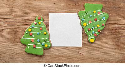lebkuchen, weihnachtsbaum, mit, leer, weißes, papier, auf, hölzern, zurück