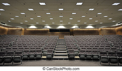 Lecture Hall - An empty lecture hall with a large amount of...