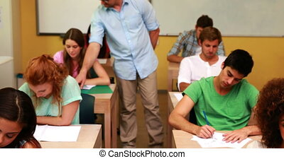 Lecturer smiling at camera in clas
