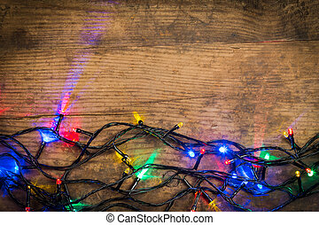 Christmas lights on wooden background