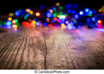 Christmas lights on wooden background - LED Christmas lights...