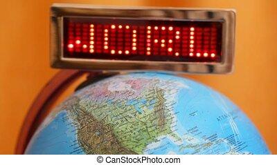 LED display withword world is on globe on an orange background
