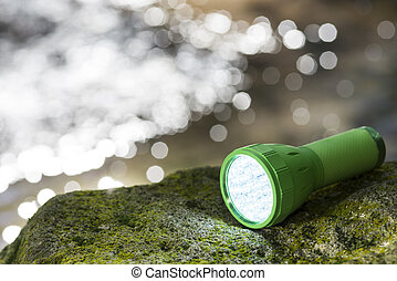 LED flashlight at waterside