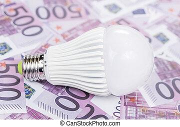 led lamp on money background
