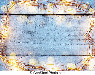 LED lighting and wire frame on wooden grunge background