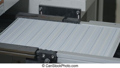 Modern technology. Machine manufactures LED panel
