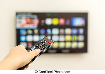LED smart TV and the remote control. - Smart TV switches to...