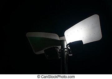 Led Streetlight in night illumination, urban outdoors.