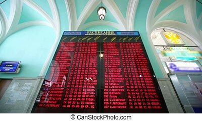 LED train schedule in Leningradsky rail terminal in Moscow,...