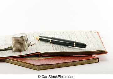 Ledgers Money Pen - two financial ledgers and a pile of...